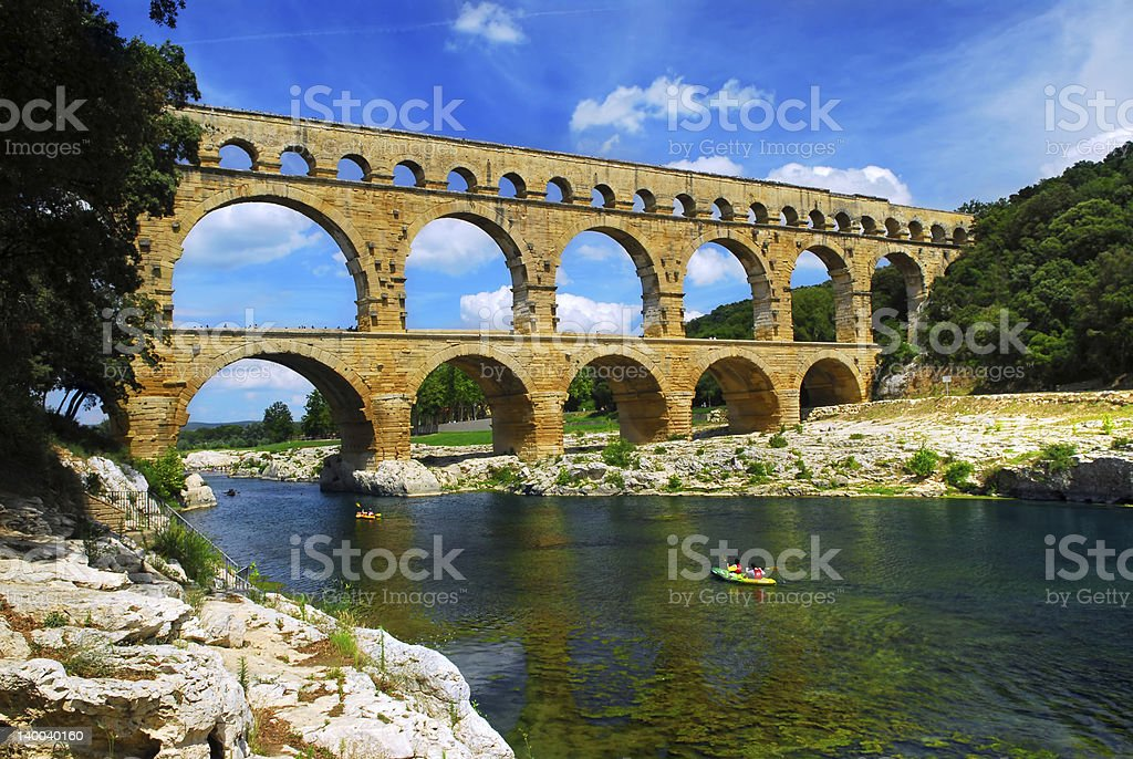 A river and Pont du Gard in southern France stock photo
