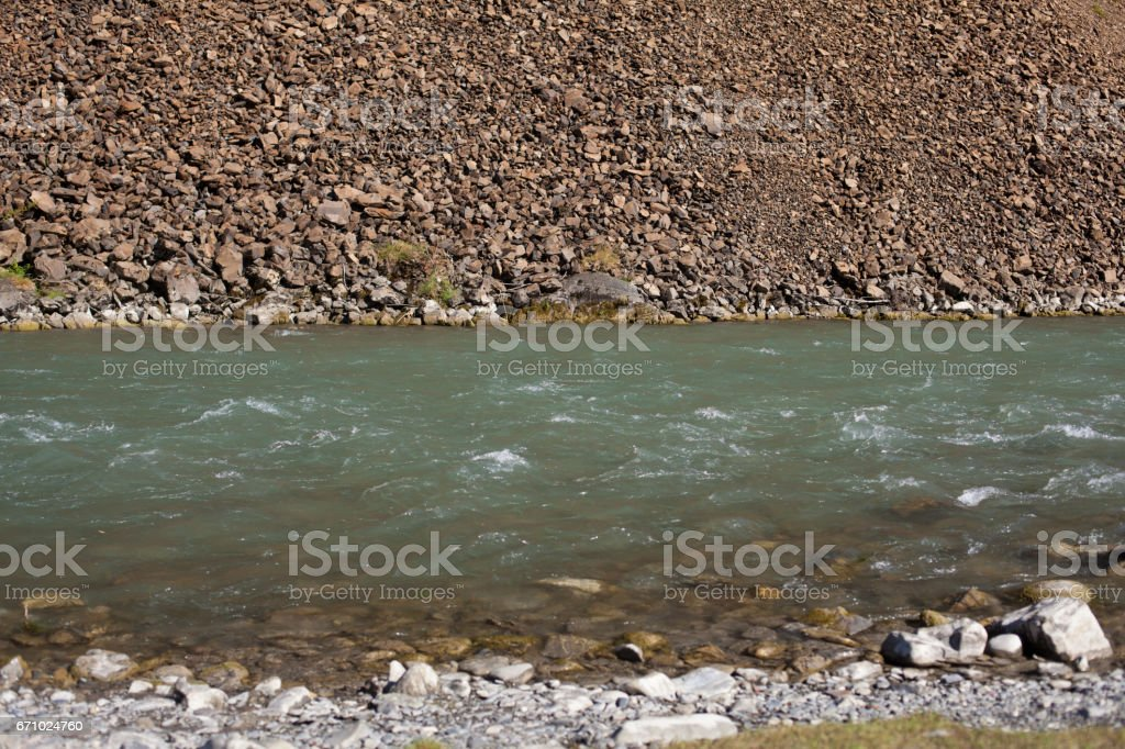 river and stone coast background stock photo