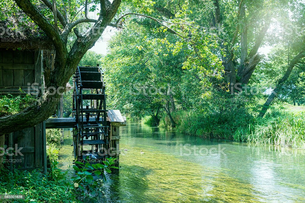 River and waterwheel stock photo