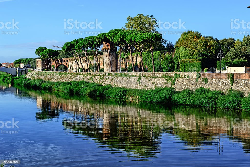 River Arno and city wall in Pisa, Italy stock photo