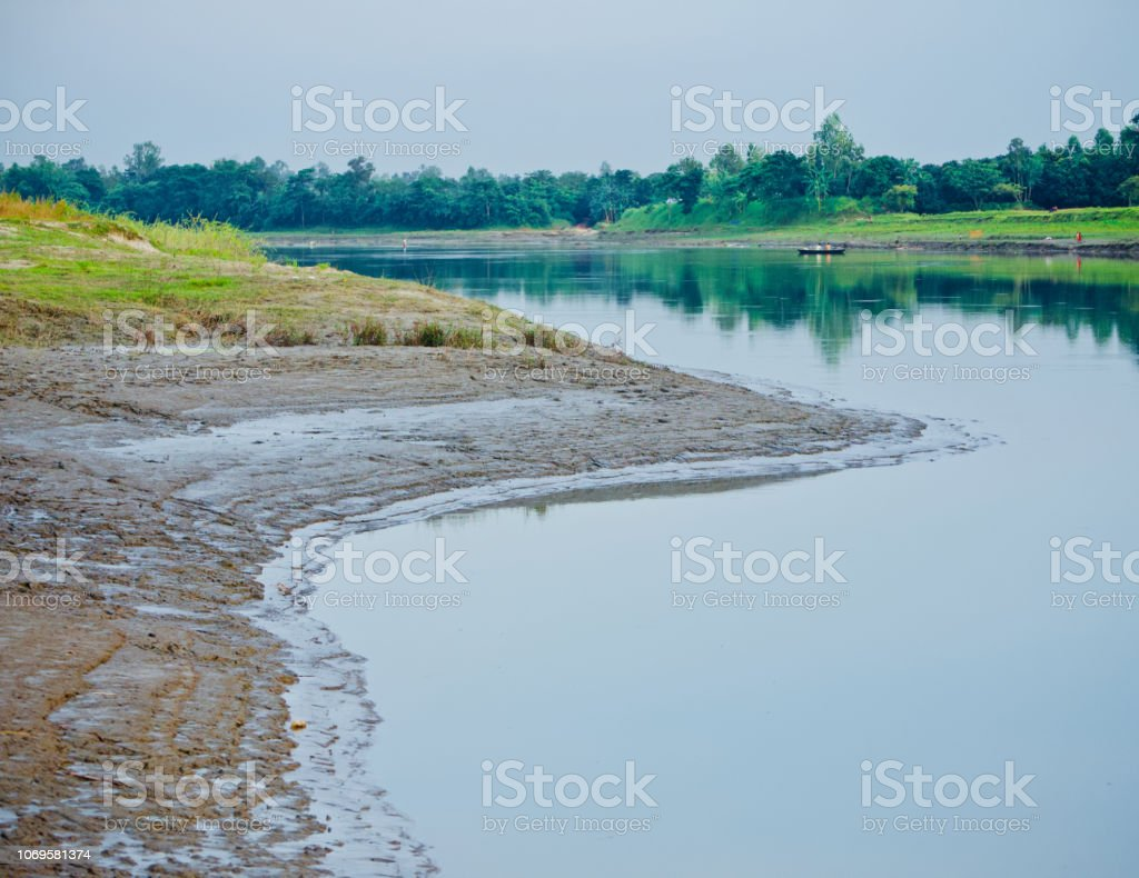 A river bank area with water unique photo stock photo