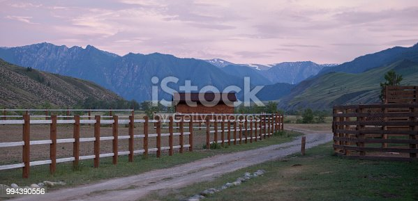 Pink sunset on the ranch in the mountains