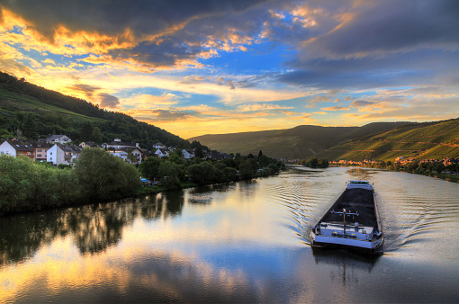 River barge at sunset on the river Moselle
