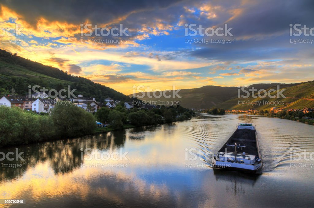 River barge at sunset on the river Moselle stock photo