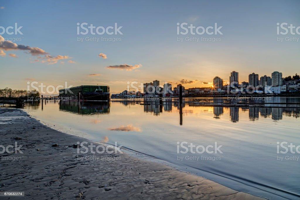 river beach at sunset stock photo