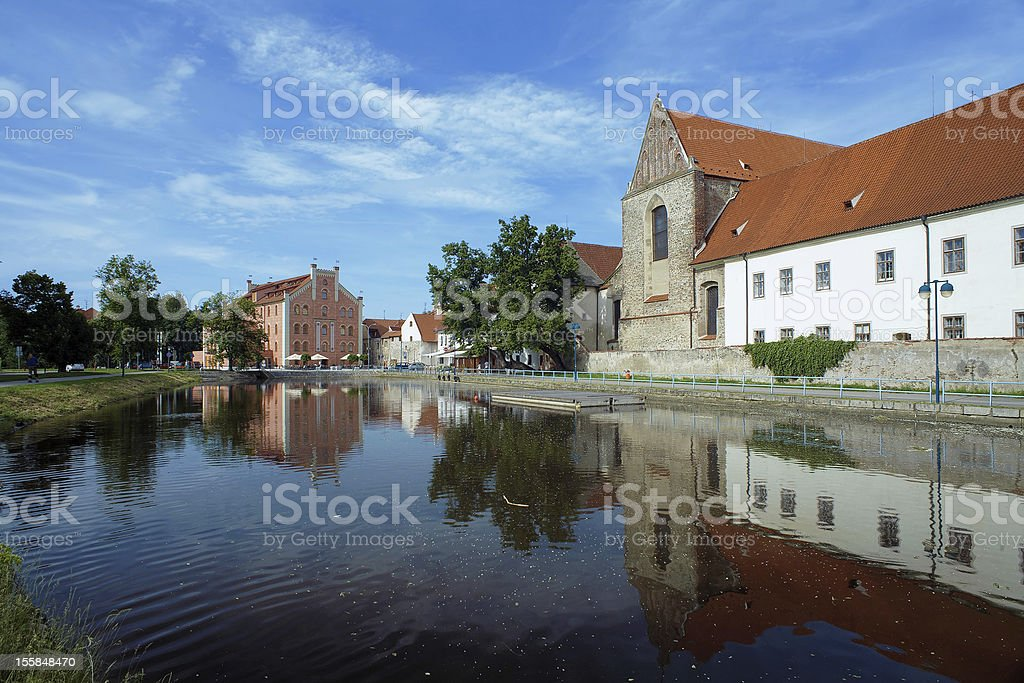 River behind the Church in Ceske Budejovice stock photo