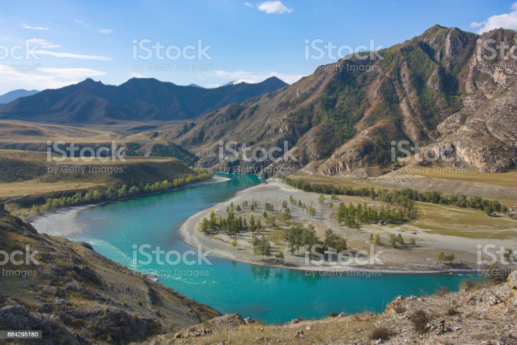 river bend against the background of mountains stock photo