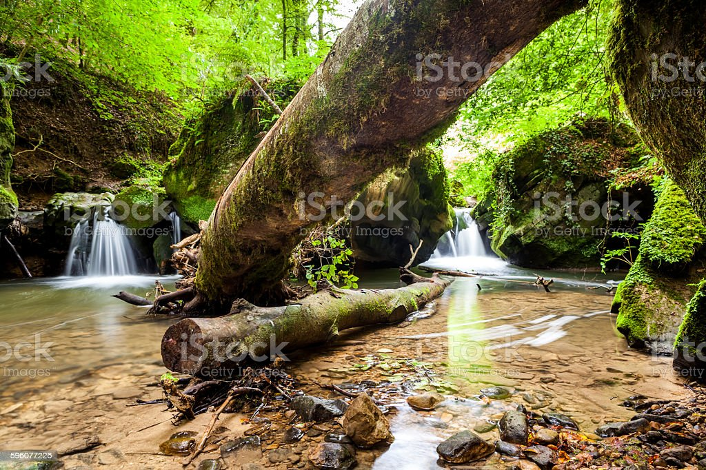 river beside a large boulder royalty-free stock photo