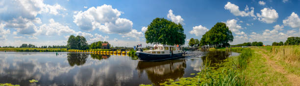 River boat at the Vecht river in Overijssel, The Netherlands stock photo
