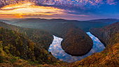 istock River canyon with dark water and autumn colorful forest. Horseshoe bend, Vltava river, Czech republic. Beautiful landscape with river 1186971539