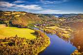 istock River canyon with dark water and autumn colorful forest. Horseshoe bend, Vltava river, Czech republic. Beautiful landscape with river. Solenice lookout. 910862156