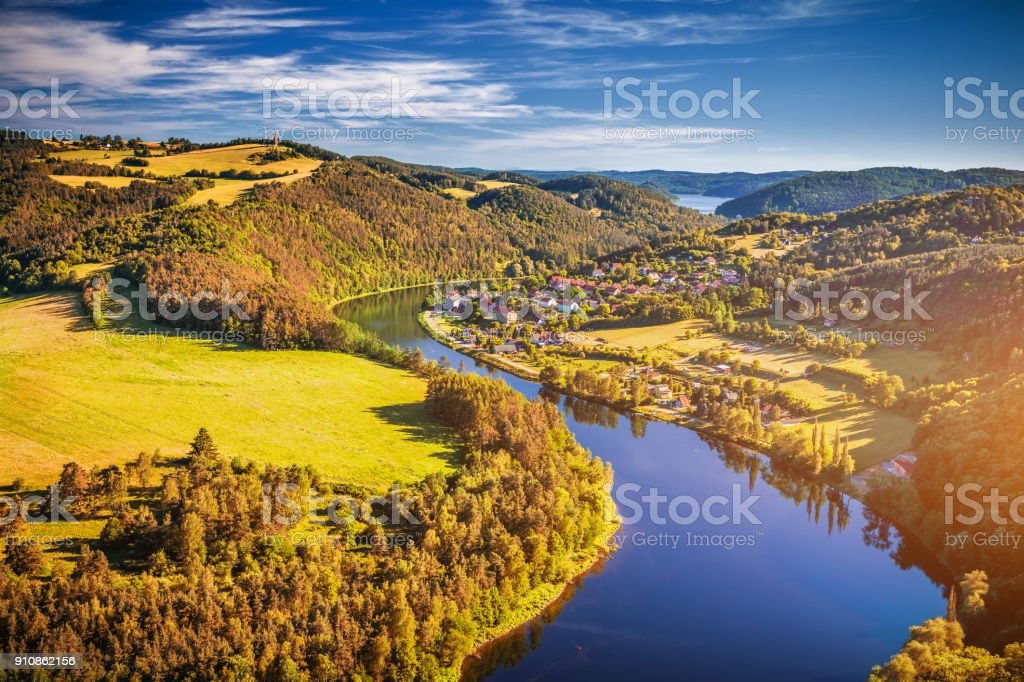 River canyon with dark water and autumn colorful forest. Horseshoe bend, Vltava river, Czech republic. Beautiful landscape with river. Solenice lookout. stock photo