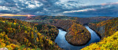 istock River canyon with dark water and autumn colorful forest 619975144