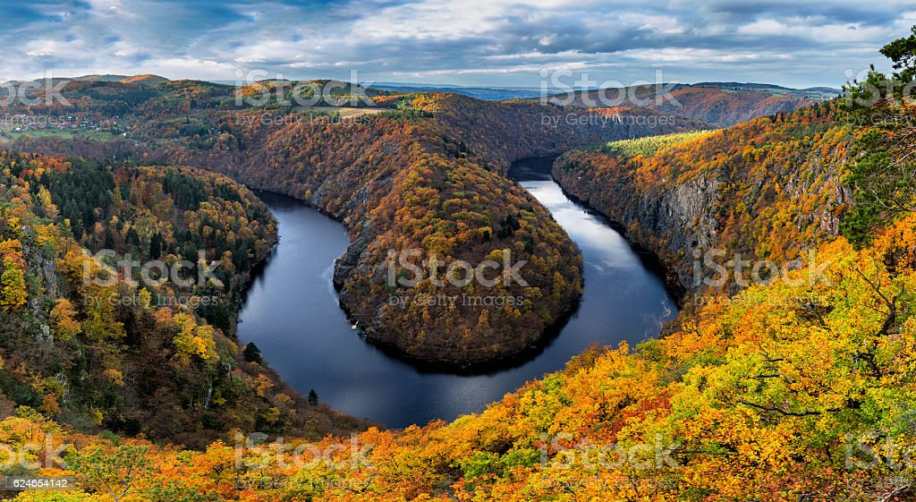 River canyon with dark water and autumn colorful forest stock photo