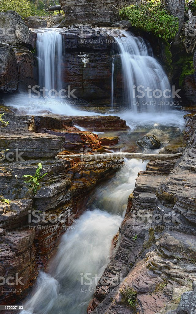 River Cascading Over and Through Rocks in Glacier National Park royalty-free stock photo
