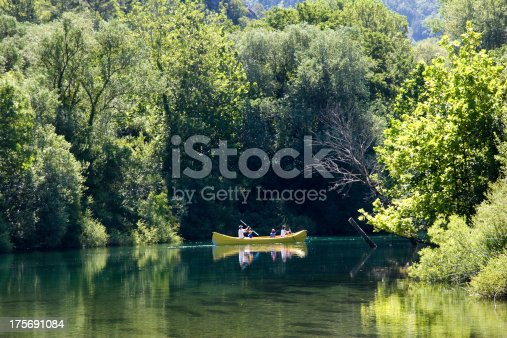 Family are rowing in canoe along the river Cetina in Croatia