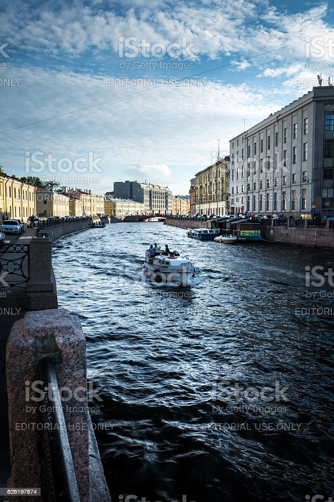 River channel with boat in Saint Petersburg stock photo