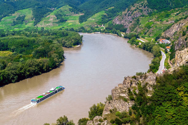 River cruise sailing by the Danube in Wachau Valley, Austria stock photo