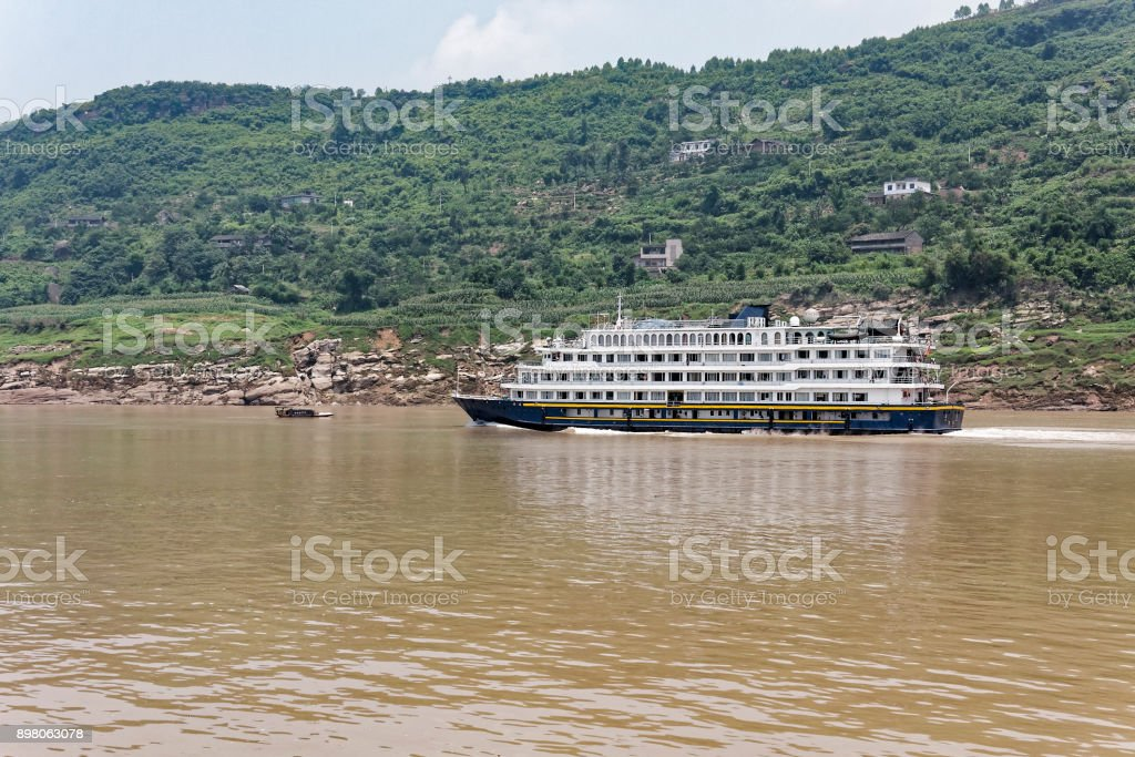 River cruise ship sailing up the Yangtze River. stock photo