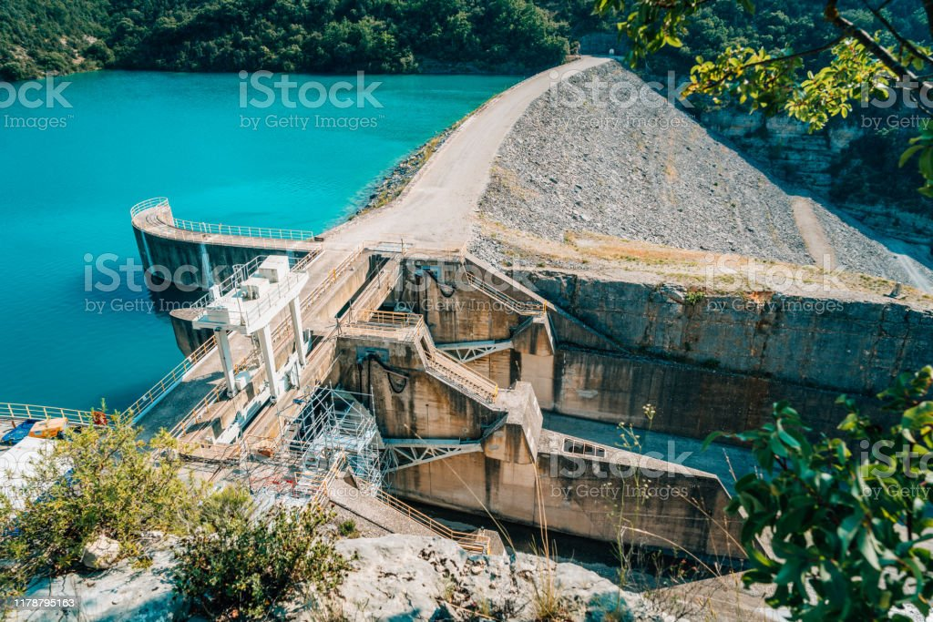 River dam seen from above, Provence, France High angle view of river dam seen in summer, Valensole, Provence, France Adventure Stock Photo