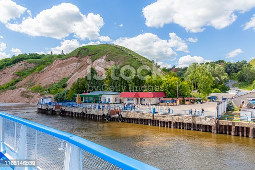 Tetyushi, Republic of Tatarstan / Russia - July 3, 2019: Berth for cruise ships on the Volga river in Tetyushi. On a Sunny summer day. Picturesque landscape. Clouds and mountains on the horizon.