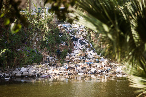 River filled with trash and plastic stock photo