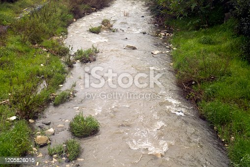 Muddy water of Garyllis river in Limassol after the heavy winter rains in Cyprus