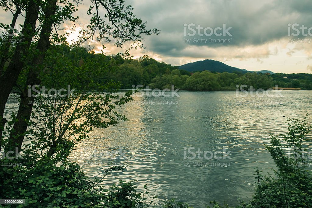 River flowing and vegetation with hills in the backgrounds royalty-free stock photo