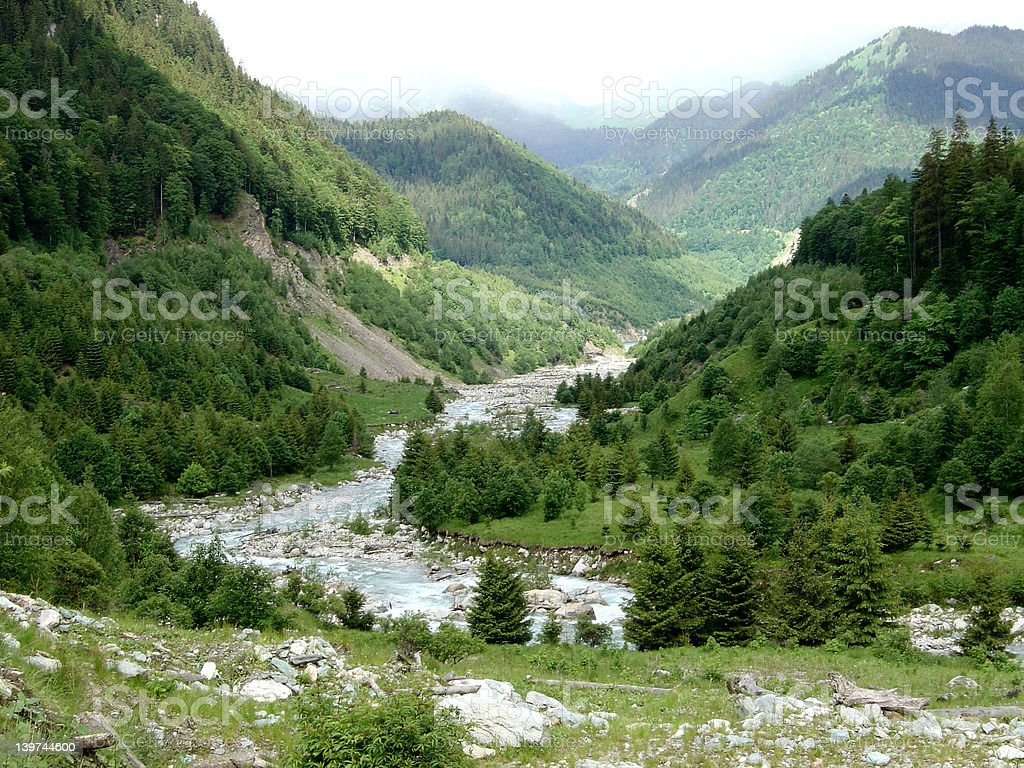 River flowing between mountains royalty-free stock photo