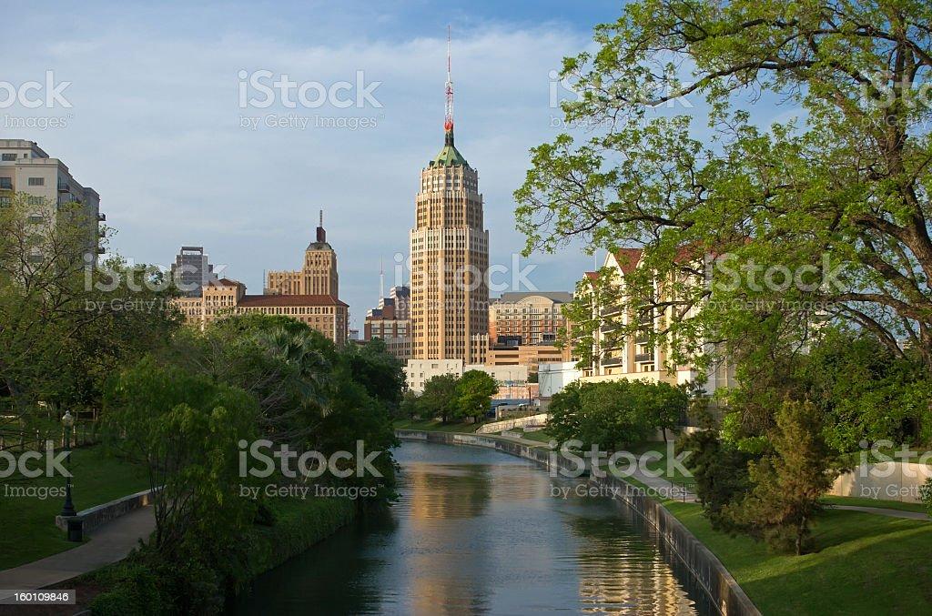 River flowing through a park towards the San Antonio skyline stock photo