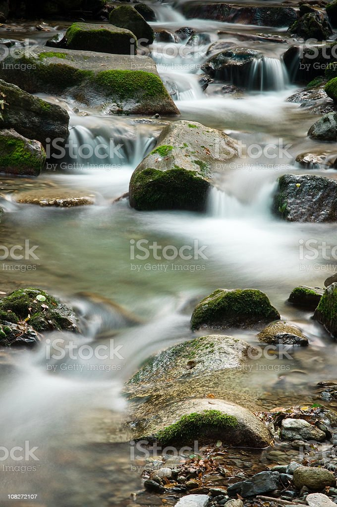 river flowing through stones royalty-free stock photo