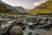 Sunrise on a small stream threading its way through the mountains of Switzerland in the Summer.