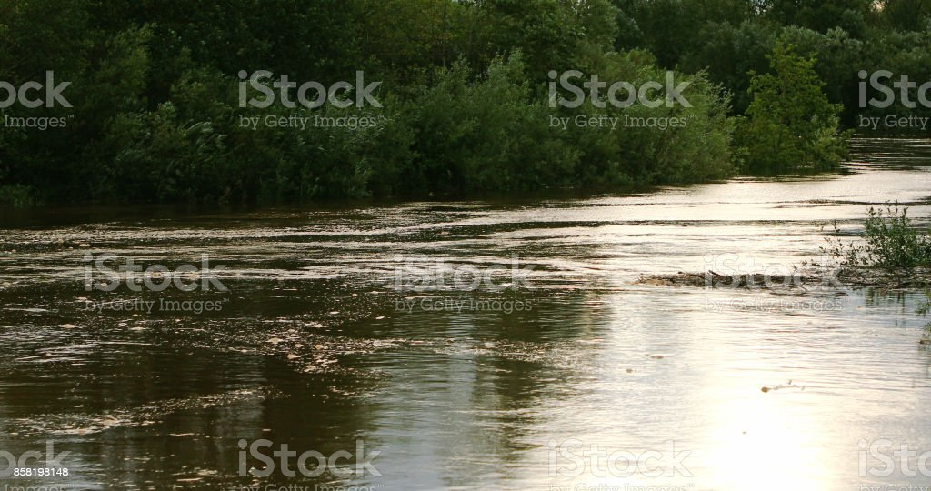 River In Flood After Large Amounts Of Rain Fall Stock Photo & More