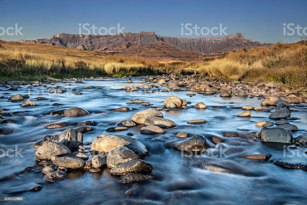 River in front of the Drakensburg stock photo