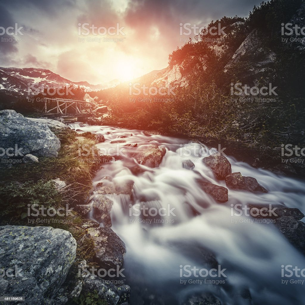 River in mountains at sunset stock photo