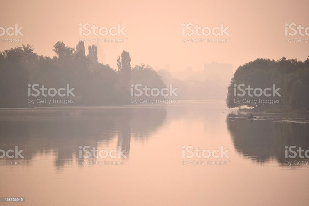 river in the fog at sunset / sunrise royalty-free stock photo