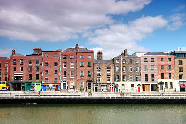 River Liffey and colorful buildings at summer day in Dublin stock photo