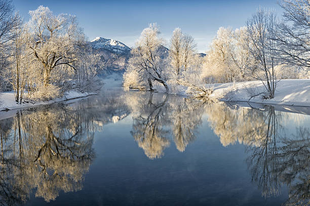 river loisach entering lake kochel in winter - february stock photos and pictures