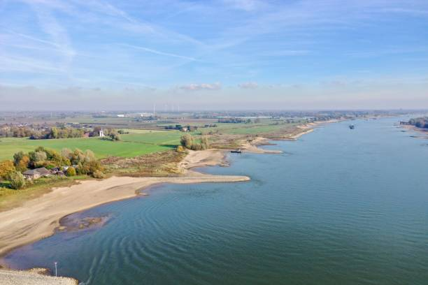 River Maas 3 November 2018: Nijmegen, the Netherlands; aerial view of the river Maas with low water due to drought and ships passing on a sunny autumn day meuse river stock pictures, royalty-free photos & images