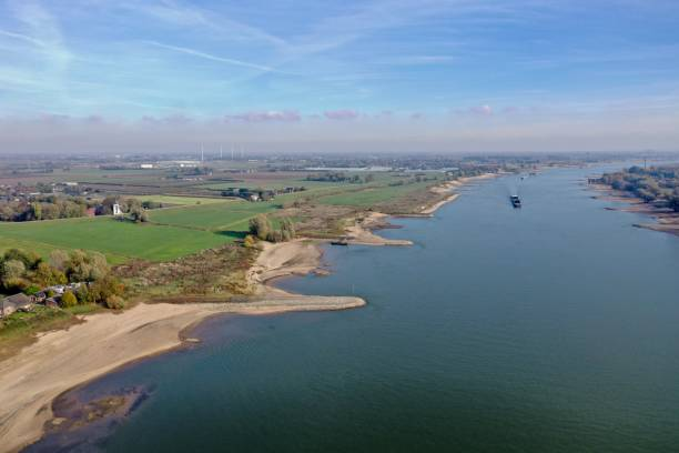 River Maas 3 November 2018: Nijmegen, the Netherlands; aerial view of the river Maas with low water due to drought and a ship passing on a sunny autumn day meuse river stock pictures, royalty-free photos & images
