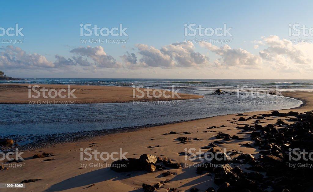River meets the ocean. stock photo