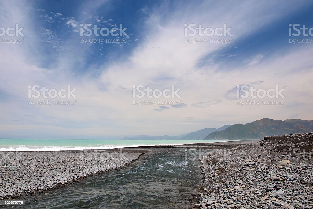 River mouth at a pebble beach stock photo