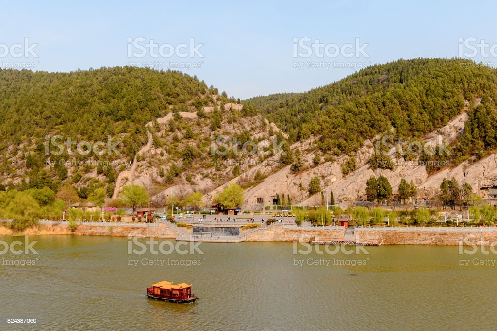 River near Longmen Grottoes ( Dragon's Gate Grottoes) or Longmen Caves.UNESCO World Heritage of tens of thousands of statues of Buddha and his disciples stock photo