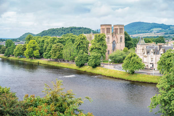River Ness and St Andrews Cathedral in Inverness Scotland UK Stock photograph of River Ness and  St Andrews Cathedral in downtown Inverness, Scotland, United Kingdom on a cloudy summer day. inverness scotland stock pictures, royalty-free photos & images