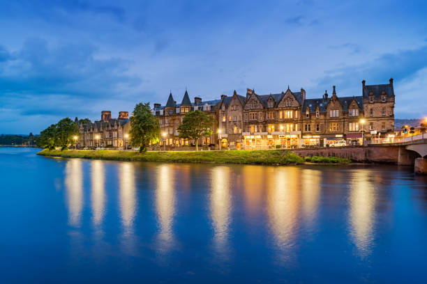 River Ness and waterfront in downtown Inverness Scotland UK Stock photograph of riverfront row houses and stores in downtown Inverness, Scotland, United Kingdom. inverness scotland stock pictures, royalty-free photos & images