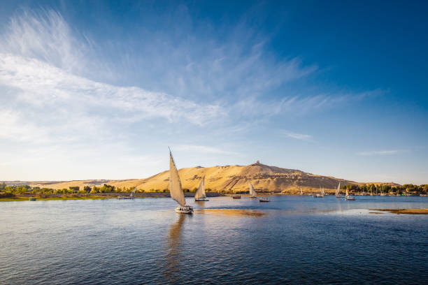 River nile with traditional boats at sunset. Live on the river Nile stock photo