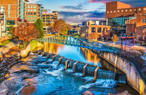 River Place and Reedy River at sunrise in Greenville, South Carolina SC. Reedy River and Skyline in Downtown Greenville South Carolina SC. liberty bridge budapest stock pictures, royalty-free photos & images