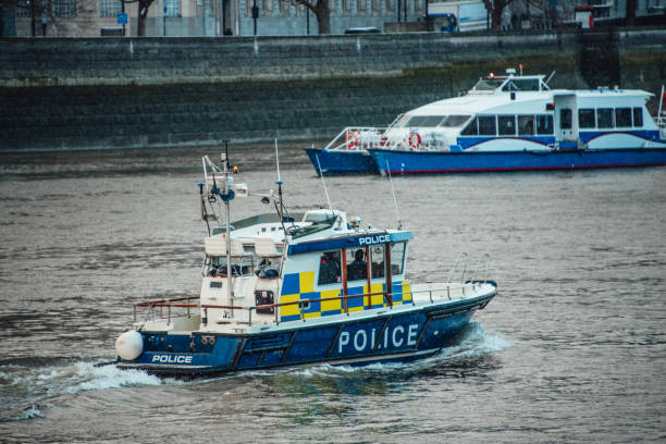 River police boat, London A river Police boat in the thames river. London, UK. counter terrorism stock pictures, royalty-free photos & images