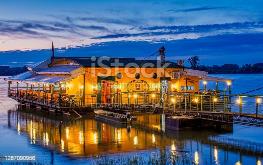 Belgrade / Serbia - February 22, 2020: Evening view of river raft restaurant and bar on the Danube river in Belgrade, Serbia