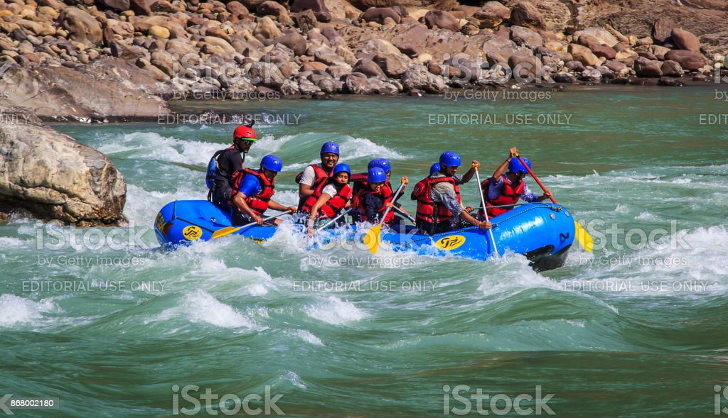 River rafting group paddling on Ganges River in Rishikesh India stock photo